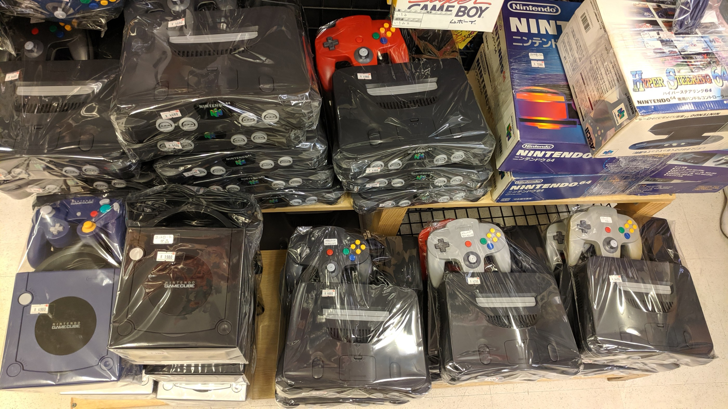 Super Potato had loads of shrink wrapped consoles for sale